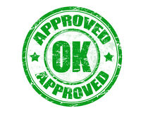 Approved stamp. Green grunge rubber office stamp with the word approved written inside Stock Image