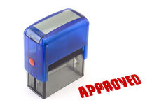Approved stamp. Blue modern self-ink rubber stamp with red Approved stamp royalty free stock photography