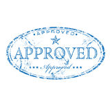 Approved stamp. Abstract grunge blue rubber stamp with star shape and the word approved written inside the stamp stock illustration
