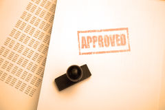 Approved stamp on paper Stock Photo