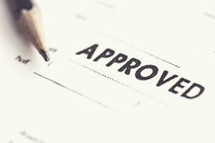 Approved stamp on white paper Stock Photo