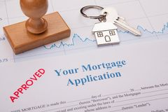 Approved Stapm and Mortgage Paper. And Pen Working stock photo