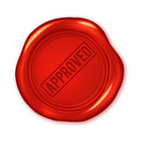 Approved text on red wax seal isolated on white Royalty Free Stock Image