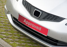 Approved used car for sale. An image of a used car for sale in sales area labeled with a bright red 'approved ' plate after servicing and valeting stock image