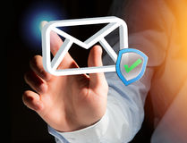 Approved and verified Email symbol displayed on a futuristic int. View of a Approved and verified Email symbol displayed on a futuristic interface - Message and Stock Photos