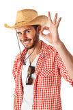 Approved. A young, attractive male in a colorful outfit ready to travel as a stereotype tourist royalty free stock photography