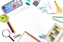 Approvisionnements d'école sur le fond blanc Image stock
