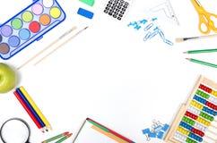 Approvisionnements d'école sur le fond blanc Photos libres de droits