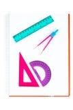 Approvisionnements d'école sur un cahier image stock