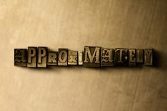 APPROXIMATELY - close-up of grungy vintage typeset word on metal backdrop. Royalty free stock illustration.  Can be used for online banner ads and direct mail Stock Images
