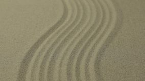 Approximation curve lines on the sand. Summer background. Texture of sand stock video footage