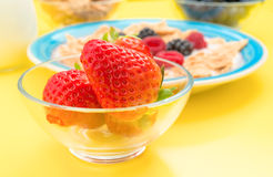 Approximation of whole strawberries in bowl with other berries Royalty Free Stock Photography