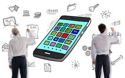Apps concept drawn by businessmen royalty free stock images