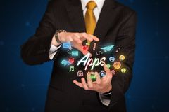 Apps della tenuta dell'uomo d'affari Fotografia Stock