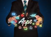 Apps della tenuta dell'uomo d'affari Fotografia Stock Libera da Diritti
