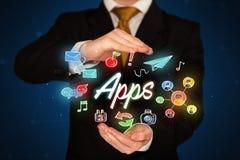 Apps della tenuta dell'uomo d'affari Immagine Stock Libera da Diritti
