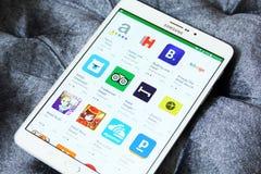 Apps di prenotazione di hotel sul gioco di Google fotografia stock libera da diritti
