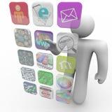 Apps en la pantalla táctil proyectada - el hombre elige uno Imágenes de archivo libres de regalías