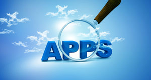 Apps and magnifying glas Stock Photo
