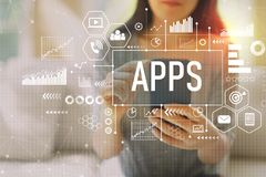 Apps med kvinnan som använder en smartphone royaltyfria bilder