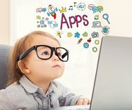 Apps text with toddler girl. Using her laptop Royalty Free Stock Photos