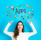 Apps with young woman looking upwards. Apps with young woman reaching and looking upwards Stock Photo