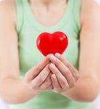 Appui rouge d'amour de santé de forme de coeur Image stock