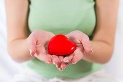 Appui rouge d'amour de santé de forme de coeur Photo libre de droits