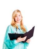 Appunti femminili sorridenti della holding del medico Fotografia Stock Libera da Diritti