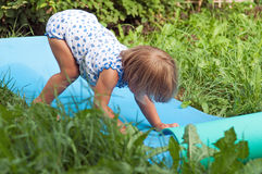 Нappy child on green grass Stock Photo