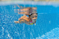 Appy underwater kid in swimming pool Royalty Free Stock Photos