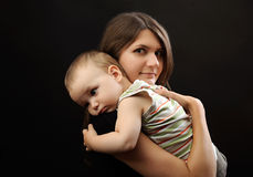 Appy young mother and toddler Royalty Free Stock Photos