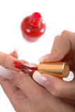 Appying Red Nail Polish Royalty Free Stock Photo