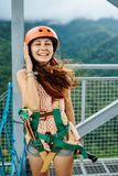 Apr 23, 2017 Adult woman, Zip line adventure at Mountain lake resort in Cavinti Philippines royalty free stock photo