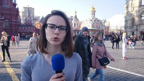 Woman Journalist And Tv Presenter Speaks Into A Microphone. APR 15, 2018 MOSCOW, RUSSIA: Woman Journalist And Tv Presenter Speaks Into A Microphone in Moscow red stock footage