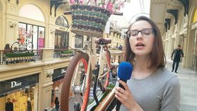Woman Journalist And Tv Presenter Speaks Into A Microphone. APR 15, 2018 MOSCOW, RUSSIA: Woman Journalist And Tv Presenter Speaks Into A Microphone in Moscow stock footage