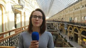 Woman Journalist And Tv Presenter Speaks Into A Microphone. APR 15, 2018 MOSCOW, RUSSIA: Woman Journalist And Tv Presenter Speaks Into A Microphone in Moscow stock video footage