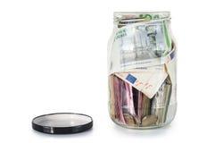 Apra il barattolo dei soldi di risparmio Fotografia Stock