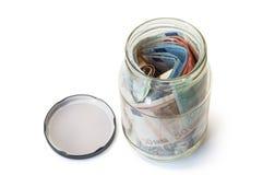 Apra il barattolo dei soldi di risparmio Fotografie Stock