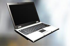 Apra il computer portatile Fotografie Stock