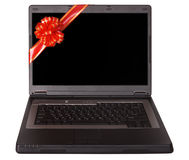Apra il computer portatile con l'arco rosso. Immagine Stock
