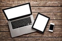 Apra il computer portatile con la compressa digitale e lo smartphone Fotografie Stock Libere da Diritti