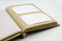 Apra il diario o il libro dell'album di foto su fondo bianco Immagini Stock