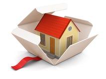 Apra il pacchetto con la casa Fotografia Stock
