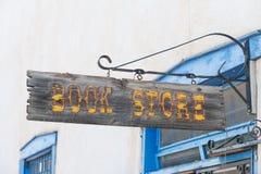 Apra il signBookstore Immagine Stock