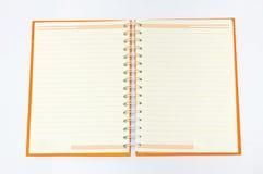 Apra il taccuino arancione Fotografia Stock Libera da Diritti