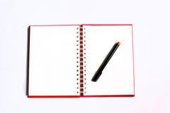 Apra il taccuino con la penna Immagini Stock