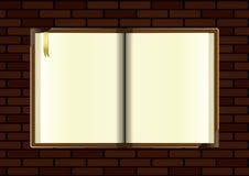 Apra il taccuino sul retro mattone Immagine Stock