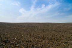 Apra il terreno coltivabile della sporcizia. fotografia stock