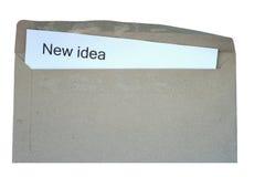 Apra la busta con la nuova parola di idea Fotografia Stock